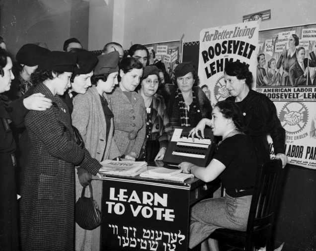 1280px-Women_voter_outreach_1935_English_Yiddish